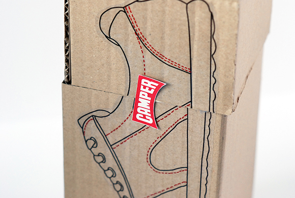 The box is closed with a Camper stickers which is placed at the exact same location as the brand is placed on the shoes inside.